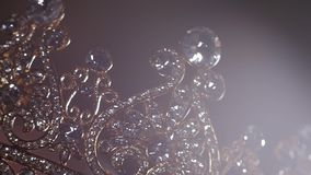 An up close image of a wedding crown in luxury Jewelry shop stock footage
