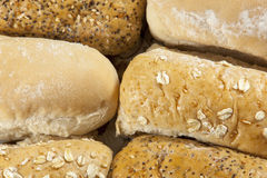 Up close shot of six wholegrain and white seeded bread rolls Royalty Free Stock Image