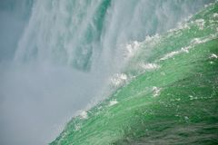 Up close to Niagara Falls. At the edge of the Niagara River torrent as it plunges over the brim of the Horseshoe Falls. It`s spectacular and exhilarating to be stock photo