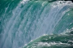 Up close to Niagara Falls. At the edge of the Niagara River torrent as it plunges over the brim of the Horseshoe Falls. It`s spectacular and exhilarating to be stock image