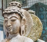 An up close view of a Buddhist Statue Meditating Stock Photo