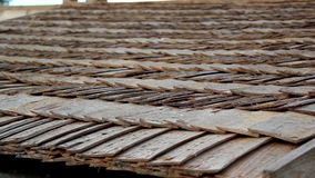 Up-close view of the cabin wooden cedar shingle shake roof. A closer image of the pile of wooden shake roof of a house; very neat and clean. An up close view of stock video