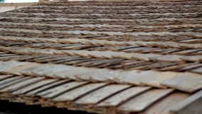 Up-close view of the cabin wooden cedar shingle shake roof stock footage