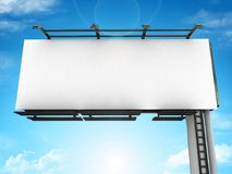 Front side view of a large billboard with lamps against a blue sky with clouds Stock Images