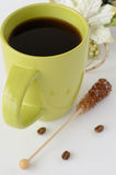 Сup of coffee. Green cup of coffee with brown sugar Stock Photo