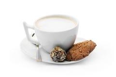 сup of coffee with chocolate candy, cookies and teaspoon Royalty Free Stock Photo