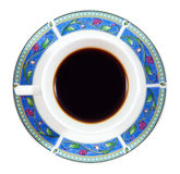 Up of coffee in a colorful plate isolated on white Stock Images