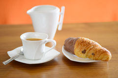 Up of coffee, croissant and a milk jug Royalty Free Stock Images