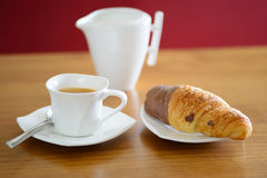 Up of coffee, croissant and a milk jug Stock Photography