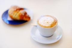 ?up of coffee and croissant on white table Royalty Free Stock Photography