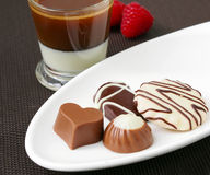 Сup of coffee espresso with milk and chocolate candies Royalty Free Stock Images