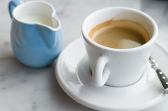 Сup of coffee and jug of milk Stock Image