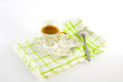 Сup of coffee on a platter. A cup of coffee on a platter Stock Images