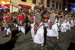 Up Country Dancers and Gatabera Players perform along the streets of Kandy during the Esala Perahera. Up Country Dancers and Gatabera Players perform along the royalty free stock photography