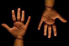 Up and down. Images of two hands one is facing up and the otehr down Royalty Free Stock Image