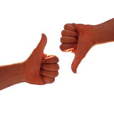 Up and down. Men's hands make thumbs up and down Royalty Free Stock Images