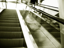 Up and down. Tinted shot of escalator. film grain/ noise is intentional Stock Images