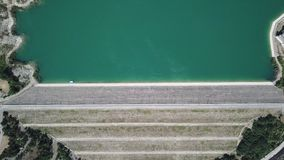 Up and down aerial view of the dam of the lake Montedoglio an artificial lake. Italy. Up and down aerial view of the dam of the lake Montedoglio an artificial stock footage