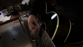 Up and down close pan shot of a guitar player stock video footage