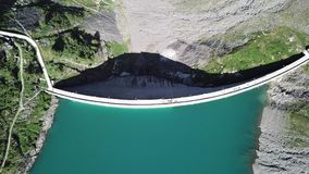 Up and down drone aerial view of the Lake Barbellino an alpine artificial lake. Italian Alps. Italy. Summer time stock video footage