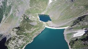 Up and down drone aerial view of the Lake Barbellino an alpine artificial lake. Italian Alps. Italy. Summer time stock video