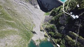 Up and down drone aerial view of the small and lower Lake Barbellino an alpine artificial lake. Italian Alps. Italy. Summer time stock video