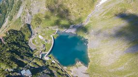 Up and down drone aerial view of the small and lower Lake Barbellino an alpine artificial lake. Italian Alps. Italy. Summer time Stock Photography