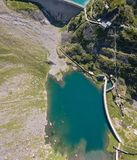 Up and down drone aerial view of the small and lower Lake Barbellino an alpine artificial lake. Italian Alps. Italy. Summer time Stock Images