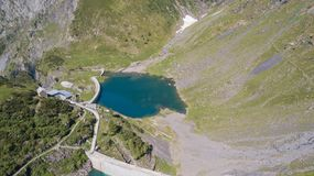 Up and down drone aerial view of the small and lower Lake Barbellino an alpine artificial lake. Italian Alps. Italy royalty free stock image