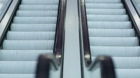 Up and down escalators. Close-up shot of empty moving staircase running up and down stock footage