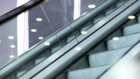 Up and down escalators. Side view of escalator in the trade centre running up and down stock footage