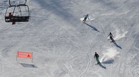 Up and down on the ski piste stock photos