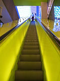 Up Escalator in Neon Yellow Royalty Free Stock Photography