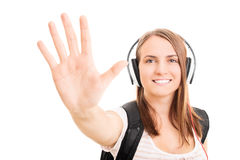 Up five. Young girl listening some music and making a high five Royalty Free Stock Images