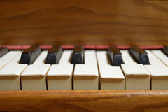 Up front view of an old wooden piano. Stock Photo