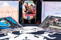 Up The Irons!. A still life of a Heavy Metal fan's memorabilia of Iron Maiden, including Albums, 'T' Shirts and a Trooper Bottle of Beer Stock Images