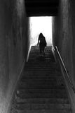 Up into the light. Shot of a dark staircase leading to light open space.  Shaken slightly to create a blur and emphasize feeling of unreality or etherealness Stock Photos