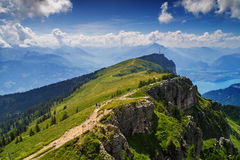 Up the Niederhorn. I took this photo from Niederhorn mountain in the Bernese Alps, looking southwest towards the gondola station and Lake Thun. August 2013 Stock Images