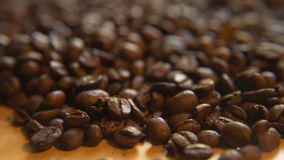 Up a Pile of Coffee Beans. Macro close up moving through lush a pile of roasted coffee beans stock footage