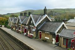 The up Platform, station and waiting room at Settle station settle -carlisle railway. The up Platform for trains to leeds with station, track and waiting room at stock photos
