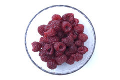 Up shot of a bowl of raspberries. Rasperries bowl on a white background Stock Photography