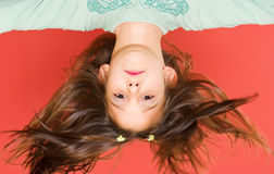 Up side down. Young girl posing up side down Stock Photography