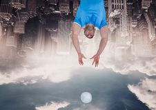 Up side down city. omen with ball. Digital composite of up side down city. omen with ball stock photo
