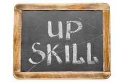 Up skill framed. Up skill phrase handwritten on vintage school slate board isolated on white Royalty Free Stock Image
