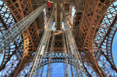 Up-skirt Eiffel. Beautiful view of the Eiffel tower seen from beneath in Paris Royalty Free Stock Photos