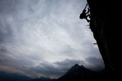 Up in the sky. Silhouette of a climber above mountain peaks. Great copy space Royalty Free Stock Images