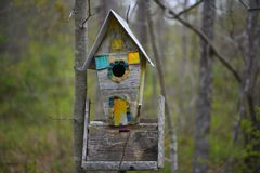 `up on 110st` dilapidated bird house with dichroic glass windows. This 8256 x 5504 UHD close up photo features a dilapidated bird house with dichroic glass Royalty Free Stock Photos
