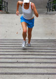 Up the Stairs 1. Action shot of woman running up stairs for cardio training Royalty Free Stock Photography
