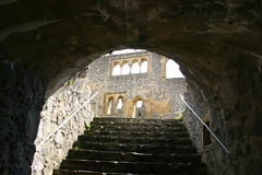 Up the stairs. View at the wall up the basement stairs Muenzenberg Castle Ruin, Hesse, Germany stock photography