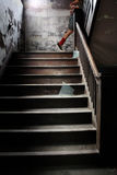 Up Stairs. A young boy runs up stairs in an abandoned building Stock Photo